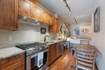 Kitchen is equipped with stainless steel appliances