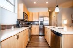 Galley style kitchen with all stainless appliances