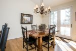 The dining area has a Kitchen table  that seats 4 with beautiful chandelier