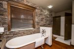 Master bath with claw foot tub and separate shower