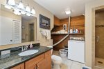 Bathroom has shower and tub with beautiful updated appliances