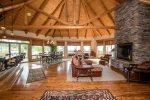 Big open floor plan, with high vaulted exposed wood ceiling.
