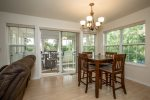 Dining room has sliding glass door that leads to covered back deck.