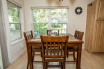 Raised dining table with seating for four.