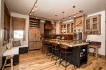 Enjoy the beauty of the granite  and hammered copper countertops