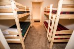 Bunk room with two twin over twin bunk beds