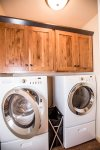 Laundry room with full-sized washer and dryer for easy clean up