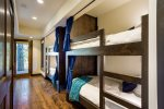 On the lower level, you`ll find private bunks with reading lights and USB ports