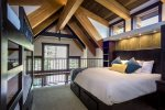 The loft bedroom sleeps four in a king and two bunks with an ensuite bathroom