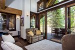 Slide the doors open for summertime indoor/outdoor living up in the trees