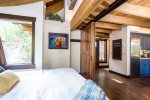The cantilevered master bedroom has sliding barn doors for privacy when desired