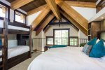 The loft bedroom sleeps 4 in a cozy king bed and 2 twin bunkbeds