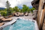 Relax in the hot tub on the spacious roof top deck