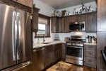Kitchen has brand new stainless steel appliances and gorgeous granite counters