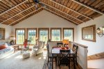 Twin Lakes Nook is on the second floor of this gorgeous log building with ample windows to soak in the meadow and mountain views