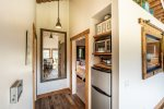 The kitchennete also has a half-size refrigerator/freezer and beautiful wood floors