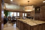 Another view of this large kitchen with plenty of bar seating