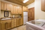 Spacious laundry room with utility sink
