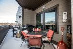 Relax out on the rooftop patio with BBQ and seating for 4