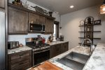 Beautiful granite kitchen counter tops, and gas range