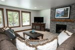 The family room downstairs features a large flat screen TV and gas fireplace.