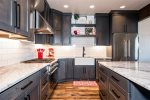 Granite countertops and stainless appliances. Foodies will love the gas range