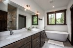perfect garden tub for soaking and separate shower with double vanities