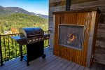 Enjoy the gas grill and fireplace on the deck