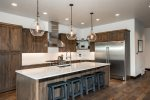 Gorgeous granite counters and stainless steel appliances in the kitchen