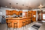 The kitchen has lovely wood cabinets, granite counters, and stainless appliances