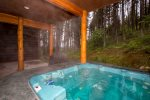 Soak in the hot tub with views of the trees