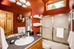 The red bathroom features a tub/shower combo