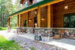 This home features beautiful wood and rock work