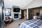Enjoy the gas fireplace and large flat-screen TV from bed