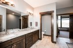 Double vanities with granite counters