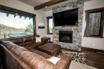 The spacious living area is the perfect place to enjoy the gas fireplace or TV