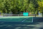 Enjoy a game of tennis on the community court
