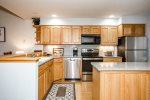 Spacious kitchen with granite countertops and stainless appliances