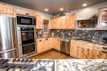 Foodies will love the kitchen with double ovens, large fridge and gas range
