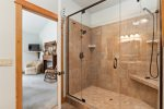 The master bedroom is on the main floor With a queen-size bed and deck access