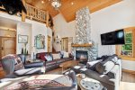 Youll love the stone fireplace and large windows in the living area