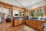 Kitchen has beautiful wood cabinets, granite counters, and stainless appliances