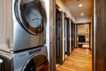 The home has a stacked washer and a dryer  for your laundry needs
