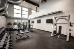 Gym is equipped with a weight rack, lifting setup, treadmills, elliptical & more