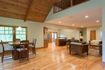 The drywall accentuates the warm wood floors, ceilings, doors, and window casings.