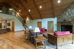 Two stories, vaulted ceilings, numeorus windows, and beautiful stone fireplace, this truly is a great room.