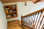 There is a built-in shelf on the stair landing before it turns to head upstairs.