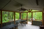 Step out on to the covered deck and you will find seating for 10. The gas grill is on the open portion of the deck.