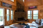 The focal point of the living is the gas-log stone fireplace.