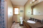 A full bath has a single vanity and walk-in shower.